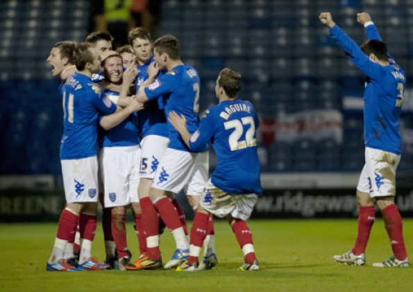Portsmouth   players congratulate David Norris after he scores to make it 2-1 against Birmingham City